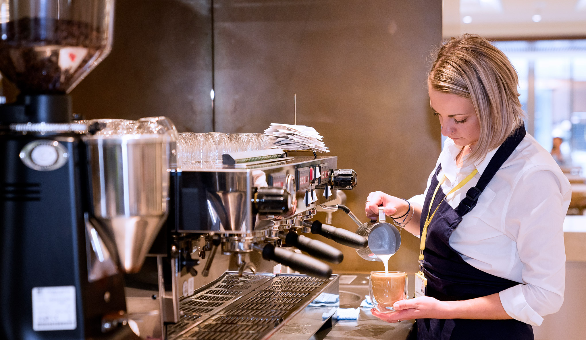 People serving delicious coffees, cakes and savoury dishes in the new café at the Royal Opera House.