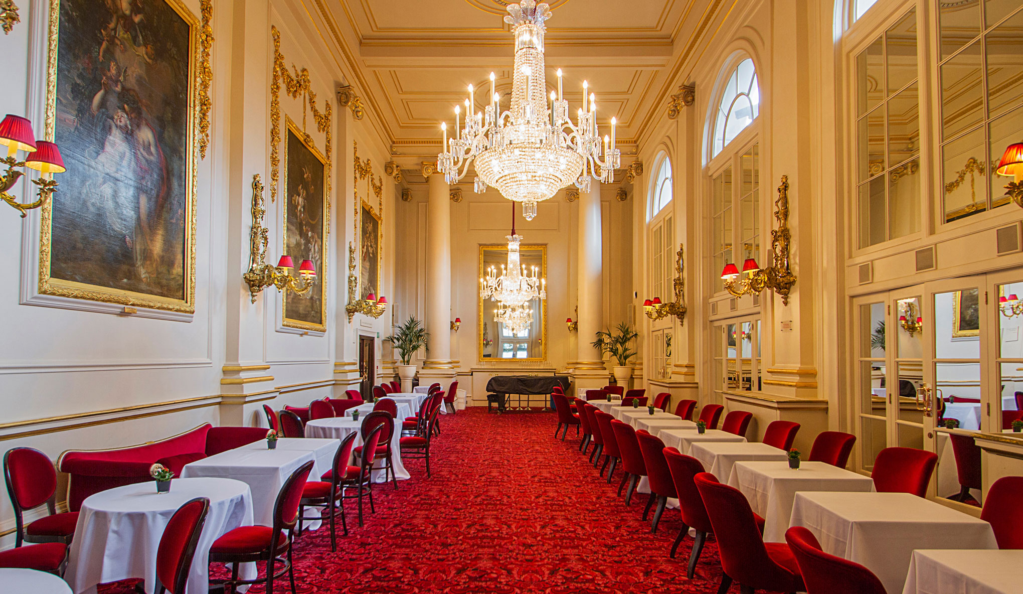 Dining tables laid out for a meal in the luxurious historic surroundings of the Crush Room